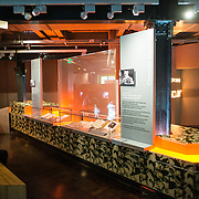 One of the exhibits at the Churchill Museum at the Churchill War Rooms in London. The museum, one of five branches of the Imerial War Museums, preserves the World War II underground command bunker used by British Prime Minister Winston Churchill. Its cramped quarters were constructed from a converting a storage basement in the Treasury Building in Whitehall, London. Being underground, and under an unusually sturdy building, the Cabinet War Rooms were afforded some protection from the bombs falling above during the Blitz.