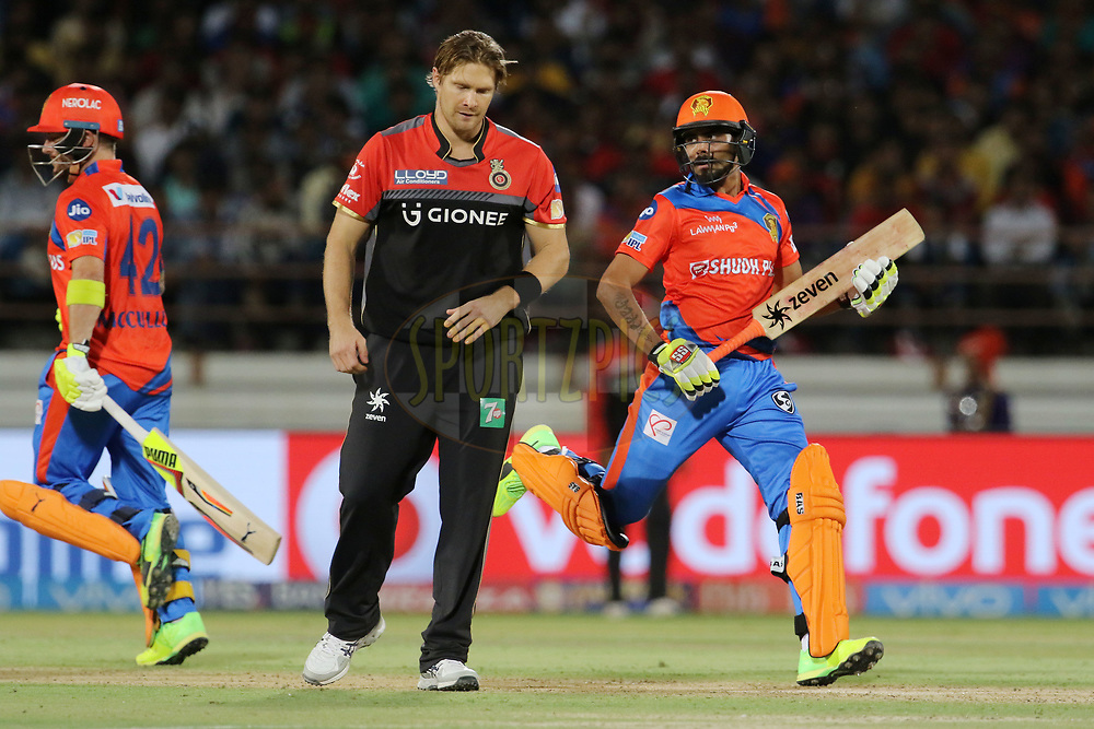 Ravindra Jadeja of the Gujarat Lions and Brendon McCullum of the Gujarat Lions takes a run during match 20 of the Vivo 2017 Indian Premier League between the Gujarat Lions and the Royal Challengers Bangalore  held at the Saurashtra Cricket Association Stadium in Rajkot, India on the 18th April 2017<br /> <br /> Photo by Vipin Pawar - Sportzpics - IPL