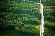 aerial perspective of rural road (White Pine Canyon Rd) through aspen forest and meadows