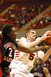 ISU's Andy Strandmark struggles with an opposing Northern Illinois Basketball player for the ball.