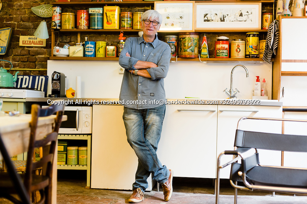 Brussels, Belgium 29 August 2014. Johan De Moor, famous Belgian cartoonist and son of Bob De Moor, right hand of Tintin's Hergé in his studio and his collection of cans. © Sander de Wilde pour M le magazine du Monde