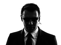 one secret service security bodyguard agent man in silhouette on white background