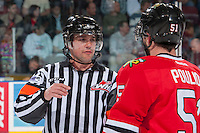 KELOWNA, CANADA - APRIL 25: Derrick Pouliot #51 of the Portland Winterhawks speaks to Pat Smith, referee at the # of the Kelowna Rockets on April 25, 2014 during Game 5 of the third round of WHL Playoffs at Prospera Place in Kelowna, British Columbia, Canada. The Portland Winterhawks won 7 - 3 and took the Western Conference Championship for the fourth year in a row earning them a place in the WHL final.  (Photo by Marissa Baecker/Getty Images)  *** Local Caption *** Pat Smith; Derrick Pouliot;