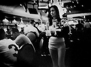 Waitress delivers another kind of water, cocktails, in a Las Vegas casino, Nevada, USA.