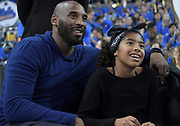 Los Angeles Lakers former guard Kobe Bryant (left) watches with daughter Gianna Maria-Onore Bryant during an NCAA women's basketball game between the Connecticut Huskies and the UCLA Bruins in Los Angeles on Tuesday, Nov. 21, 2017. UConn defeated UCLA 78-60.