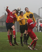 Occidental (red) on the attack against Fintry Athletic (yellow) in the Riverview Utilities Consulting Ltd Dundee Sunday FA League - Premier Division at Claypotts<br /> <br />  - &copy; David Young - www.davidyoungphoto.co.uk - email: davidyoungphoto@gmail.com