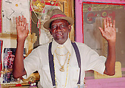 Reverand Dennis,90 yr.old, jolds up his hands to praise the lord. He is devoted to preaching the Bible. Reverand Dennis is pictured on his porch in Vicksburg,MS.(photo/Suzi Altman) Pictures is Miss margaret's Grocery, also known as Rev.Dennis's Castle, in Vicksburg Mississippi. Located on the Blues Highway, HWY 61 North, this folk art Palace is in recent times in need of repair. A non profit is being set up to help preserve the property since Miss Margaret's death in 2008. rev. Dennis is now in nursing home and 94 yrs. old. His works of art and bus he lovingly turned into a church with Margaret's help need to be protected for future generations to enojy. Photo©SuziAltman