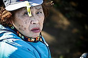 elderly Japanese woman looking