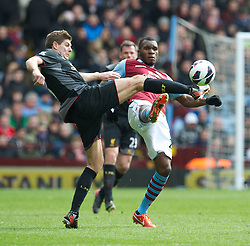 BIRMINGHAM, ENGLAND - Easter Sunday, March 31, 2013: Liverpool's captain Steven Gerrard in action against Aston Villa's Christian Benteke during the Premiership match at Villa Park. (Pic by David Rawcliffe/Propaganda)