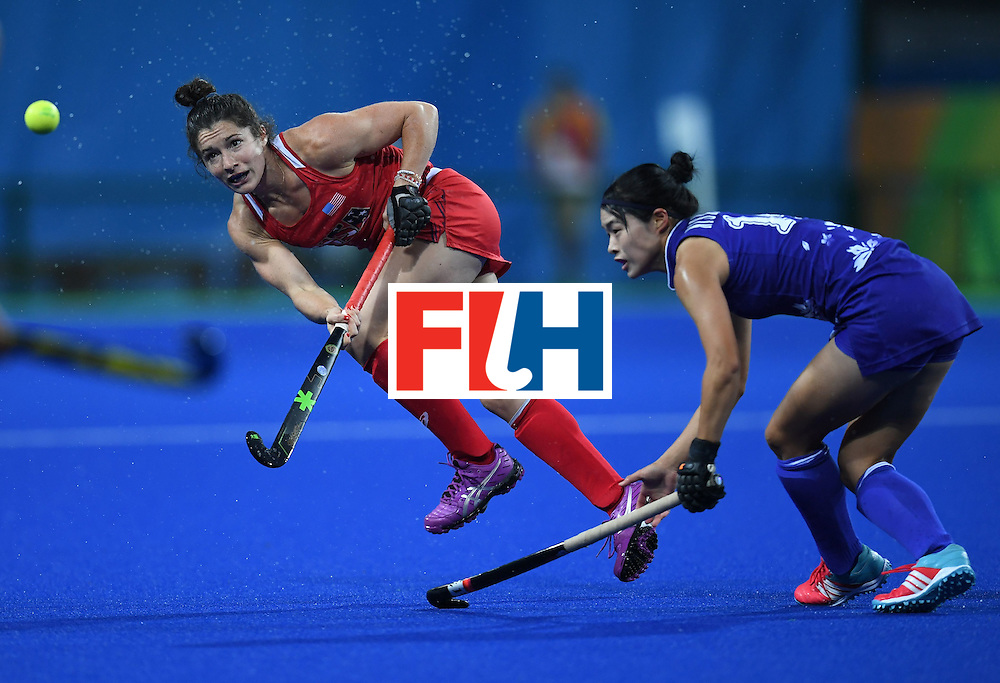 The USA's Michelle Vittese hits the ball during the women's field hockey USA vs Japan match of the Rio 2016 Olympics Games at the Olympic Hockey Centre in Rio de Janeiro on August, 10 2016. / AFP / MANAN VATSYAYANA        (Photo credit should read MANAN VATSYAYANA/AFP/Getty Images)
