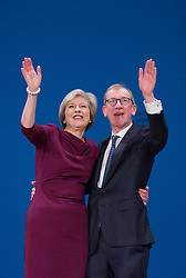 Prime Minister Theresa May and husband Philip John May greet the audience after the end of her main speech to delegates in the final day of the Conservative party conference at the International Convention Centre, ICC, Birmingham. Wednesday October 5, 2016. Photo credit should read: Isabel Infantes / EMPICS Entertainment.
