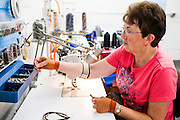 DEXTER, ME - AUGUST 4, 2015:  Anne Clukey (60) assembles the strap for a handbag at Erda Handbags, whose employees are mostly 60 years or older. Clukey works about 30 hours a week with a flexible schedule.<br /> Craig Dilger for The New York Times