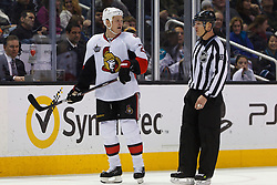 Jan 19, 2012; San Jose, CA, USA; Ottawa Senators right wing Chris Neil (25) is escorted to the penalty box by NHL linesman Vaughan Rody (73) during the second period against the San Jose Sharks at HP Pavilion. Ottawa defeated San Jose 4-1. Mandatory Credit: Jason O. Watson-US PRESSWIRE