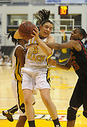 Dec 3, 2009; Long Beach, CA, USA; Long Beach State guard Lauren Sims (3) battles for a rebound with Southern California Trojans guard Briana Gilbreath (15) at the Walter Pyramid. USC defeated Long Beach State 83-77.