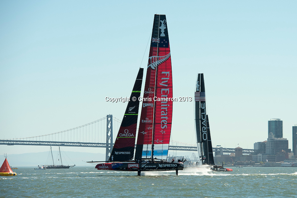 Oracle Team USA head to the finish as Emirates Team New Zealand approach the final turning mark in race 16 on day 13 of America's Cup 34. 23/9/2013
