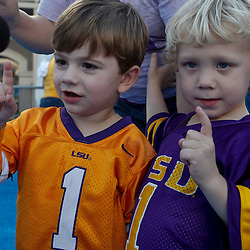 January 8, 2012; New Orleans, LA, USA; LSU Tiger fans Colin Tallet and Owen Nugent  at the Fan Fest pep rally in the French Quarter for the 2012 BCS National Championship game to be played on January 9, 2012 between the Alabama Crimson Tide and the LSU Tigers at the Mercedes-Benz Superdome.  Mandatory Credit: Derick E. Hingle-US PRESSWIRE