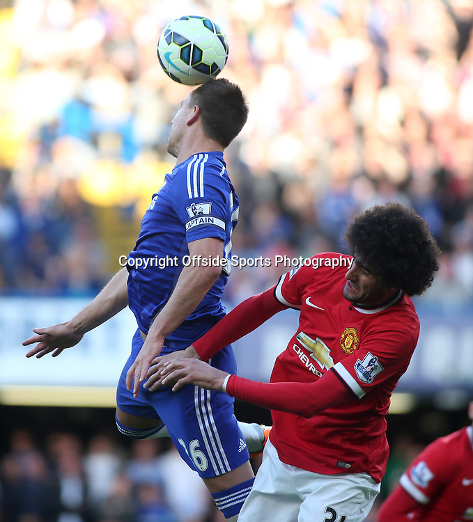 18 April 2015 - Barclays Premier League - Chelsea v Manchester United - John Terry of Chelsea beats Marouane Fellaini of United to the header.<br /> <br /> <br /> Photo: Ryan Smyth/Offside