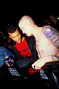 Punks at gig. black and white punk rockers chatting. london astoria. 1997