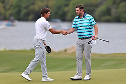 March 29, 2019 - Austin, Texas, United States - Bryson DeChambeau (L) shakes hands with Marc Leishman on the 14th green during the third round of the 2019 WGC-Dell Technologies Match Play at Austin Country Club. (Credit Image: © Debby Wong/ZUMA Wire)