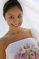 Bride with bouquet outdoors (close-up) (portrait)