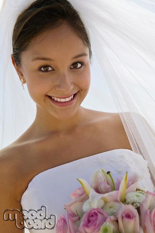 Bride with bouquet outdoors (close-up) (portrait)