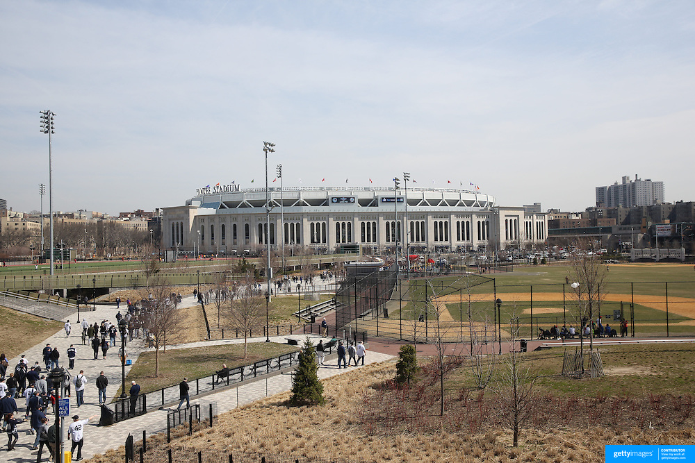 Fans head to Yankee Stadium during the New York Yankees Vs Toronto Blue Jays season opening day at Yankee Stadium, The Bronx, New York. 6th April 2015. Photo Tim Clayton