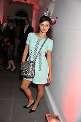BIP LING at a party hosted by Ines de la Frassange and Bruno Frisoni for Roger Vivier to launch the Roger Vivier book held at The Saatchi Gallery, London on 24th April 2013.
