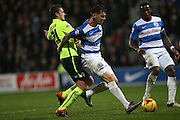 Queens Park Rangers defender Grant Hall (4) holds off Brighton striker (on loan from Manchester United), James Wilson (21) during the Sky Bet Championship match between Queens Park Rangers and Brighton and Hove Albion at the Loftus Road Stadium, London, England on 15 December 2015.