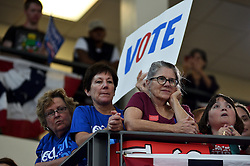 Voters are seen listening to former President Bill Clinton in the Philadelphia, Pennsylvania suburbs during a Stronger Together campaign rally in support of his wife Hillary Clinton, the Democratic presidential nominee in the race for the 2016 U.S. Presidential Elections.
