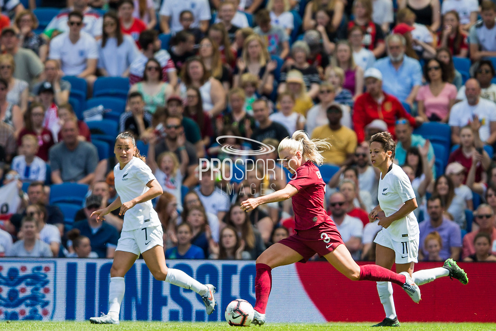 Alex Greenwood (England) with the ball and Ali Riley (Capt) (New Zealand) and Sarah Gregorius (New Zealand) in the background during the FIFA Women's World Cup UEFA warm up match between England Women and New Zealand Women at the American Express Community Stadium, Brighton and Hove, England on 1 June 2019.
