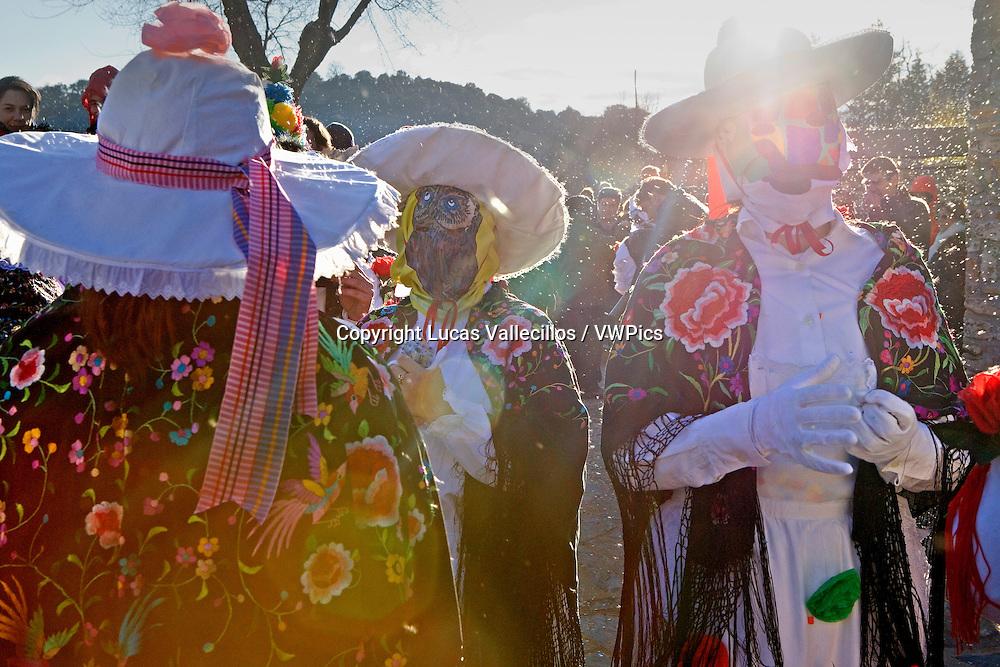 Mascaritas. Fluff of reeds in the air. Carnival, Almiruete. Tamajon, Guadalajara province, Castilla-La Mancha, Spain