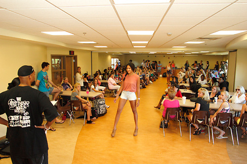 Models show designer L'Amour A-K Ameer (left) their runway walk as he auditions prospective models during a Dayton Fashion Week meeting at SunWatch Indian Village/Archaeological Park in Dayton, Saturday, July 21, 2012.  Designers were both selecting models and doing fittings of their clothes at the meeting, in preparation for Dayton Fashion Week, which begins with Fashion For A Cause on July 21st, and concludes with the Finale Runway Showcase at the Dayton Convention Center on July 28th.