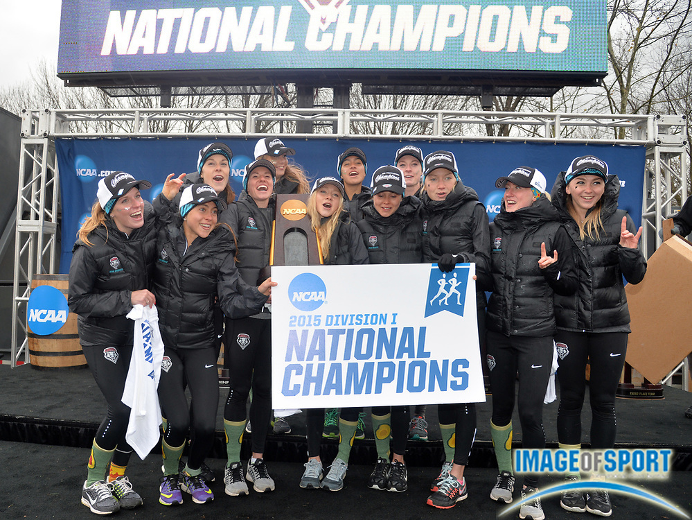 Nov 21, 2015; Louisville, KY, USA; New Mexico runners pose with the championship plaque after winning the womens team title during the 2015 NCAA cross country championships at Tom Sawyer Park.