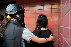 Tuen Mun, Hong Kong. 22 September 2019. Pro democracy demonstration and march through Tuen Mun in Hong Kong. Marchers protesting against harassment by sections of the pro Beijing community. Largely peaceful march had several violent incidents with police using teargas. Several arrests were made. Pictured; Arrest of female protestor.  Iain Masterton Live News.