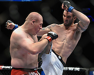 """LONDON, ENGLAND, OCTOBER 2010: Rob Broughton (left) evades a knee strike from Vinicius Queiroz during """"UFC 120: Bisping vs. Akiyama"""" inside the O2 Arena in Greenwich, London"""