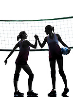 two caucasian women volleyball in studio silhouette isolated on white background