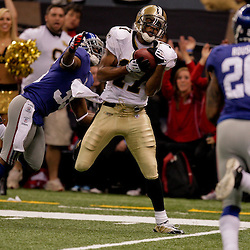 2009 October 18: New Orleans Saints wide receiver Robert Meachem (17) catches a pass over New York Giants cornerback Kevin Dockery (35) during a 48-27 win by the New Orleans Saints over the New York Giants at the Louisiana Superdome in New Orleans, Louisiana.