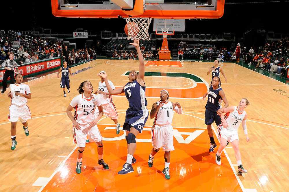 December 7, 2010: Adria Crawford of the Georgetown Hoyas shoots past Selina Archer (54) and Riquna Williams (1) of the Miami Hurricanes during the NCAA basketball game between Georgetown and Miami. The 'Canes defeated the Hoyas 81-72.