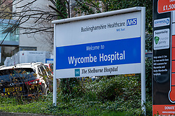 "© Licensed to London News Pictures. 13/03/2020. High Wycombe, UK. A sign at the main entrance to Wycombe Hospital in High Wycombe. A Buckinghamshire Healthcare NHS Trust spokesperson has said ""A small number of patients at Wycombe Hospital and Stoke Mandeville Hospital have tested positive for coronavirus (COVID-19). The patients are being cared for appropriately at the hospitals where they continue to be monitored and treated. Photo credit: Peter Manning/LNP"