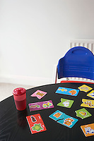 High chair at table with child's jigsaw puzzle