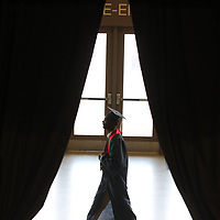 A Nettleton senior makes his way into the BancorpSouth Arena Saturday to get his diploma with his classmates.