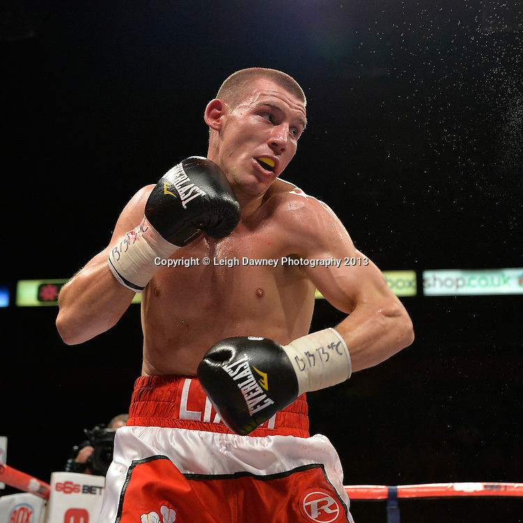 Liam Walsh defeats Ronnie Heffron after Heffron's corner retired him. British Light Middleweight Title eliminator on 26th July 2014 at the Phones 4U Arena, Manchester. Promoted by Frank Warren. © Credit: Leigh Dawney Photography.