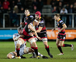 Dragons' Aaron Wainwright is tackled by Ospreys' Justin Tipuric<br /> <br /> Photographer Simon King/Replay Images<br /> <br /> Guinness Pro14 Round 12 - Dragons v Cardiff Blues - Sunday 31st December 2017 - Rodney Parade - Newport<br /> <br /> World Copyright © 2017 Replay Images. All rights reserved. info@replayimages.co.uk - http://replayimages.co.uk
