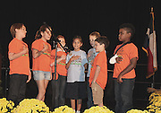 Wilson Montessori students lead the pledge during the Mayor's Proud Partners Luncheon on Monday, Oct. 28, 2013, at the Hilton Americas in downtown Houston. The school was honored for its SPARK park program.