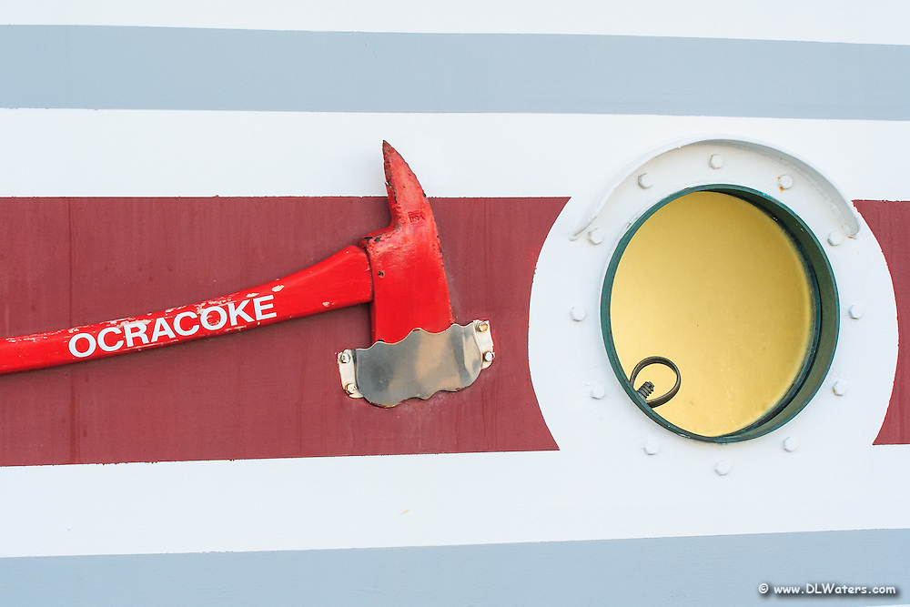 Ocracoke car ferry fire axe and porthole. The Ocracoke car ferry is one of a fleet of ferry's that runs between Hatteras Island and Ocracoke Island.