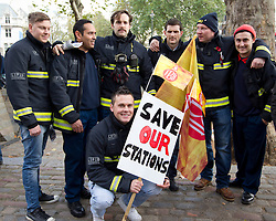 © Licensed to London News Pictures. 07/11/2012. London, UK. Firefighters with placards are seen at a Firefighters demonstration in London today (07/11/12). The protest and rally were held in response to what the Fire Brigades Union has said are 'dangerous cuts' to staff and stations.  Photo credit: Matt Cetti-Roberts/LNP