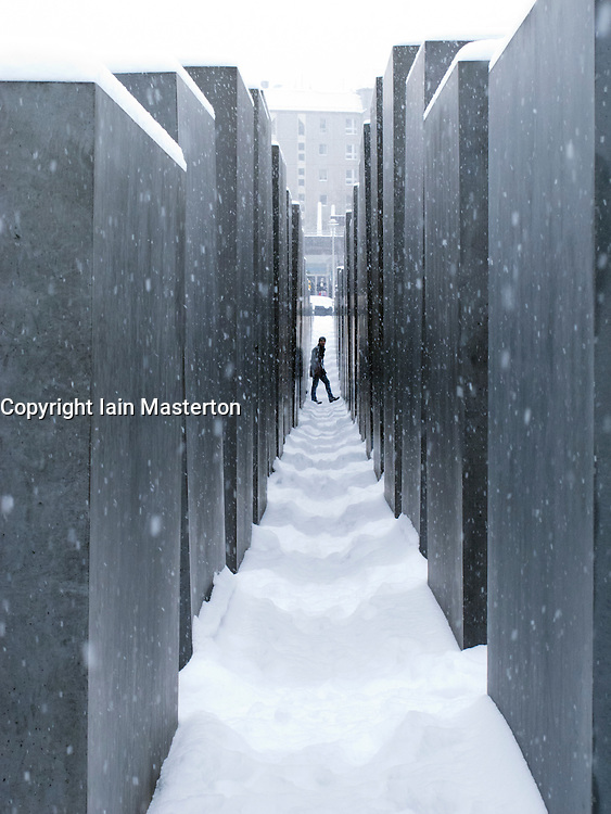 View of the Holocaust Memorial in winter with snow in Berlin, Germany