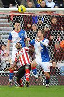 Football - Premier League - Sunderland vs. Blackburn Rovers.<br /> Stephane Sessegnon (Sunderland) battles with Morten Gamst Pedersen (Blackburn Rovers) at the Stadium of Light.