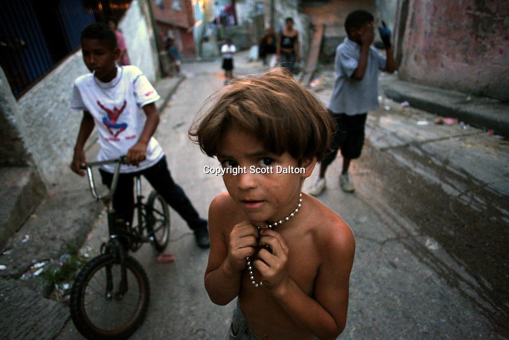 A young boy hangs out with his friends in Calle 13, a heavy pro-Chavez barrio in Caracas, on Monday, November 27, 2006. (Photo/Scott Dalton)