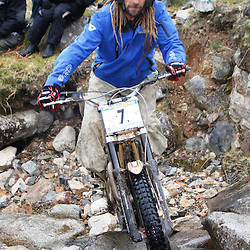 Gary Collinson England with dreadlocks tries hard to negotiate the heavy boulders on the lagnaha section near duror in argyll.  The six day trial pits man and machine against the heavy highland terrain with the winner having he best times on each of the stages at the end of the six days. picture kevin mcglynn | STOCKPIX